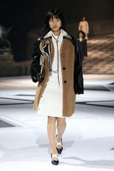 6ea8ea847f41c ... Miuccia Prada presents several versions of vintage oversized jackets  and coats